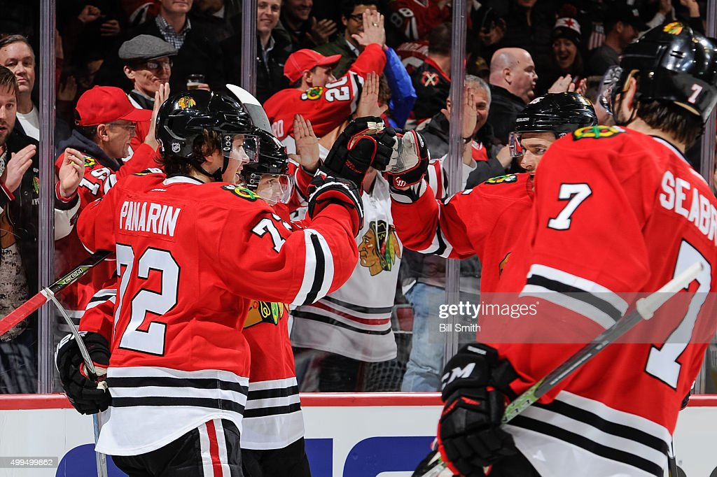 <a gi-track='captionPersonalityLinkClicked' href=/galleries/search?phrase=Patrick+Kane&family=editorial&specificpeople=1977261 ng-click='$event.stopPropagation()'>Patrick Kane</a> #88 of the Chicago Blackhawks (middle) celebrates with Artemi Panarin #72 , <a gi-track='captionPersonalityLinkClicked' href=/galleries/search?phrase=Artem+Anisimov&family=editorial&specificpeople=543215 ng-click='$event.stopPropagation()'>Artem Anisimov</a> #15 and <a gi-track='captionPersonalityLinkClicked' href=/galleries/search?phrase=Brent+Seabrook&family=editorial&specificpeople=638862 ng-click='$event.stopPropagation()'>Brent Seabrook</a> #7 after scoring against the Minnesota Wild in the second period of the NHL game at the United Center on December 1, 2015 in Chicago, Illinois.