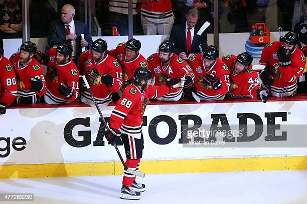 Patrick Kane of the Chicago Blackhawks celebrates with his teammates on the bench after scoring a goal in the third period against the Tampa Bay...