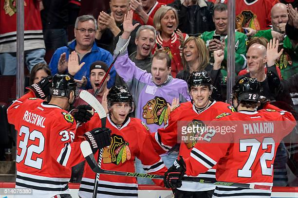 Patrick Kane of the Chicago Blackhawks celebrates with Michal Rozsival Trevor van Riemsdyk and Artemi Panarin after scoring in the first period of...
