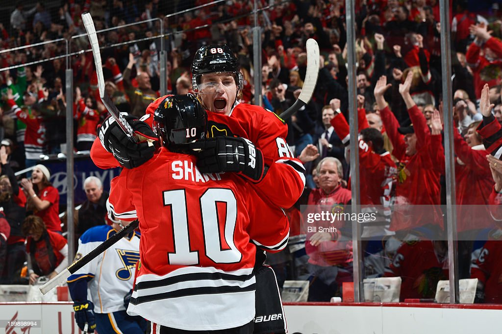 Patrick Kane #88 of the Chicago Blackhawks celebrates with teammate <a gi-track='captionPersonalityLinkClicked' href=/galleries/search?phrase=Patrick+Sharp&family=editorial&specificpeople=206279 ng-click='$event.stopPropagation()'>Patrick Sharp</a> #10 after scoring against the St. Louis Blues in the first period on January 22, 2013 at the United Center in Chicago, Illinois.