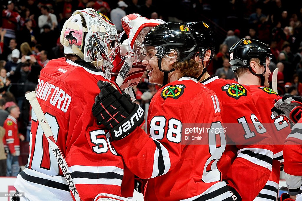 Patrick Kane #88 of the Chicago Blackhawks celebrates with teammate goalie <a gi-track='captionPersonalityLinkClicked' href=/galleries/search?phrase=Corey+Crawford&family=editorial&specificpeople=818935 ng-click='$event.stopPropagation()'>Corey Crawford</a> #50 after the Blackhawks defeated the Nashville Predators 3-2 during the NHL game on April 01, 2013 at the United Center in Chicago, Illinois.