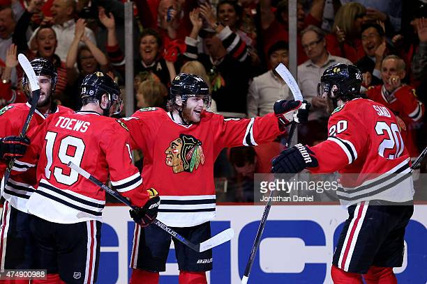 Patrick Kane of the Chicago Blackhawks celebrates with teammates after scoring a second period goal against the Anaheim Ducks in Game Six of the...