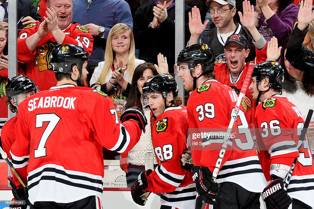 Patrick Kane #88 of the Chicago Blackhawks celebrates with teammates, including (L-R) <a gi-track='captionPersonalityLinkClicked' href=/galleries/search?phrase=Duncan+Keith&family=editorial&specificpeople=4194433 ng-click='$event.stopPropagation()'>Duncan Keith</a> #2, <a gi-track='captionPersonalityLinkClicked' href=/galleries/search?phrase=Brent+Seabrook&family=editorial&specificpeople=638862 ng-click='$event.stopPropagation()'>Brent Seabrook</a> #7, Jimmy Hayes #39 and Dave Bolland #36 after scoring in the second period against the Los Angeles Kings during the NHL game on March 25, 2013 at the United Center in Chicago, Illinois.