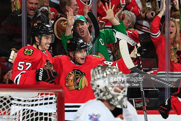 Patrick Kane of the Chicago Blackhawks celebrates with Trevor van Riemsdyk after scoring against the New York Islanders in the second period of the...
