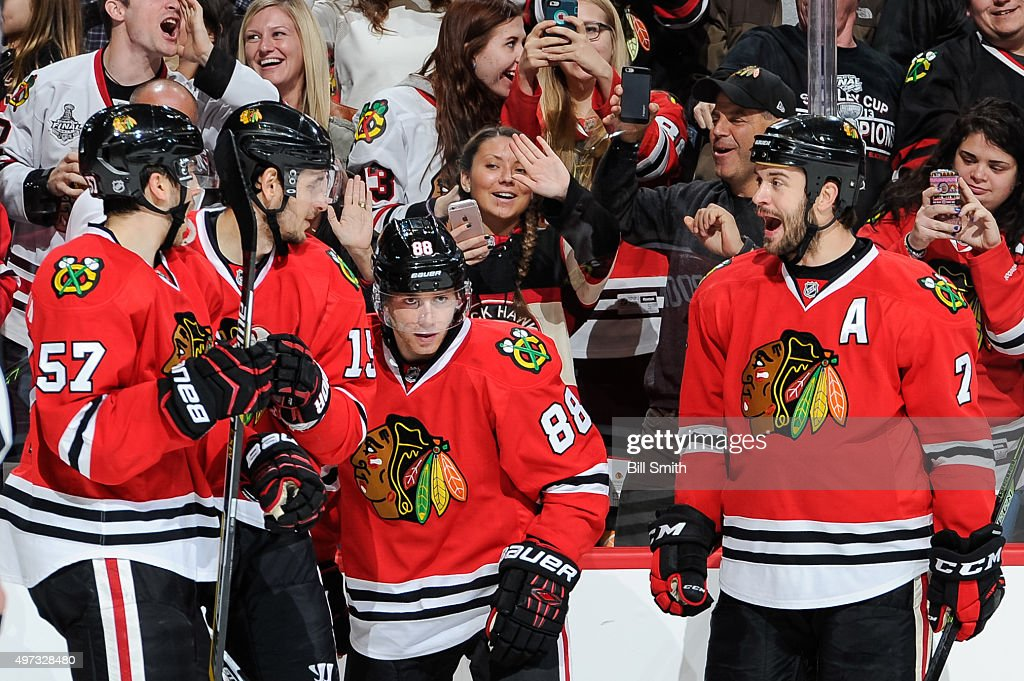 Patrick Kane of the Chicago Blackhawks celebrates with Trevor van Riemsdyk Artem Anisimov and Brent Seabrook after scoring against the Calgary Flames...