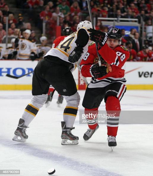 Patrick Kane of the Chicago Blackhawks collides with Carl Soderberg of the Boston Bruins at the United Center on January 19 2014 in Chicago Illinois