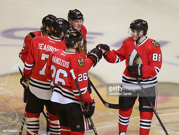 Patrick Kane of the Chicago Blackhawks congratulates teammate Brent Seabrook after a goal against the Philadelphia Flyers as Michal Handzus Duncan...