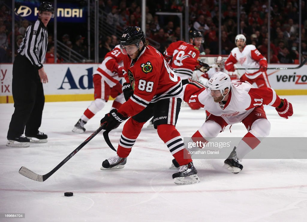 Patrick Kane #88 of the Chicago Blackhawks controls the puck in front of <a gi-track='captionPersonalityLinkClicked' href=/galleries/search?phrase=Daniel+Cleary&family=editorial&specificpeople=220490 ng-click='$event.stopPropagation()'>Daniel Cleary</a> #11 of the Detroit Red Wings in Game Five of the Western Conference Semifinals during the 2013 NHL Stanley Cup Playoffs at the United Center on May 25, 2013 in Chicago, Illinois. The Blackhawks defeated the Red Wings 4-1.