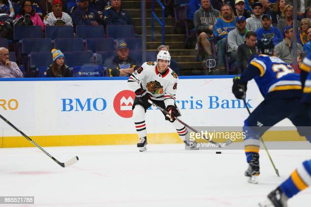 Patrick Kane of the Chicago Blackhawks handles the puck against the St Louis Blues at the Scottrade Center on October 18 2017 in St Louis Missouri