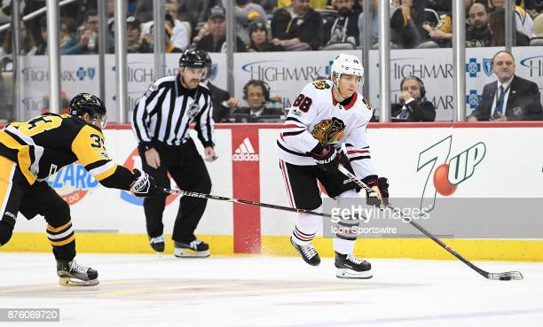 Patrick Kane of the Chicago Blackhawks handles the puck as Greg McKegg of the Pittsburgh Penguins defends in the third period during the game at PPG...