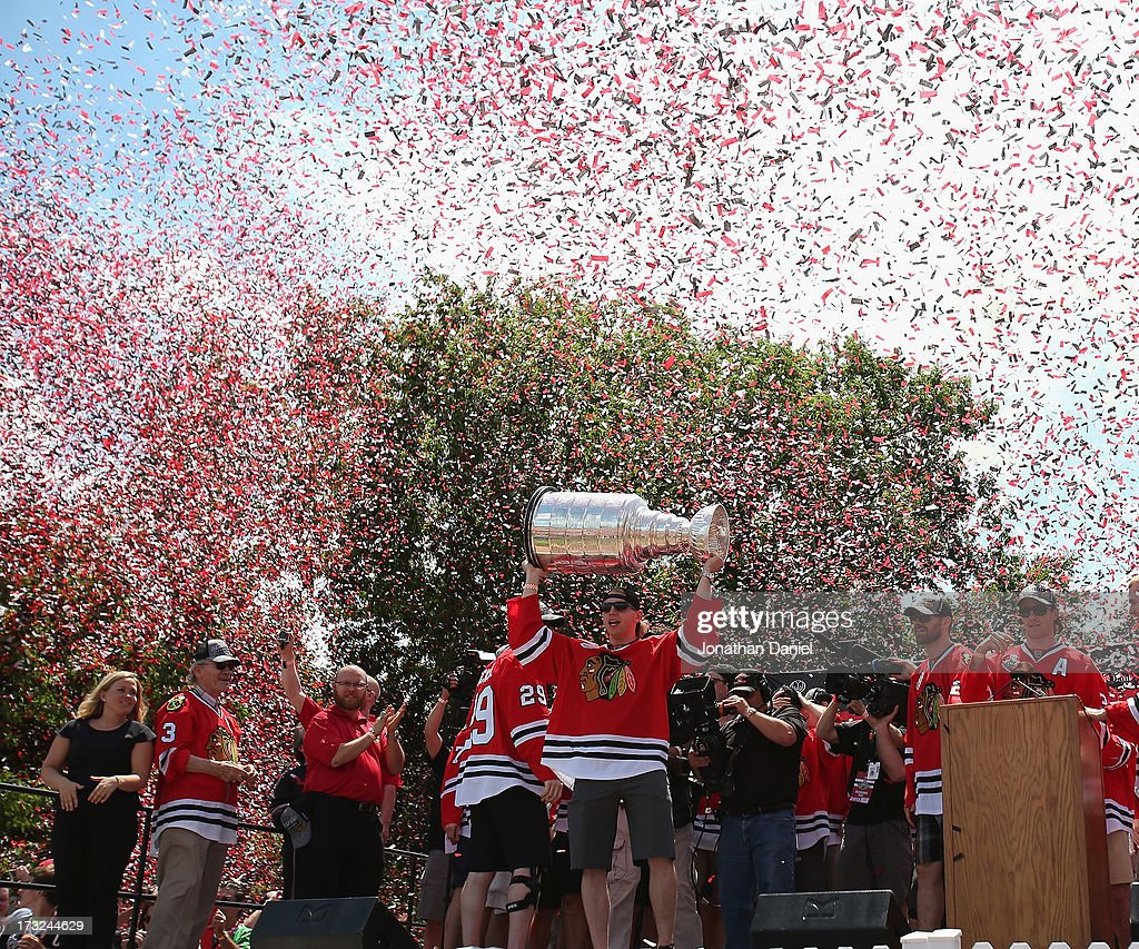 <a gi-track='captionPersonalityLinkClicked' href=/galleries/search?phrase=Patrick+Kane&family=editorial&specificpeople=1977261 ng-click='$event.stopPropagation()'>Patrick Kane</a> #88 of the Chicago Blackhawks holds the Stanley Cup Trophy during the Blackhawks Victory Parade and Rally on June 28, 2013 in Chicago, Illinois.