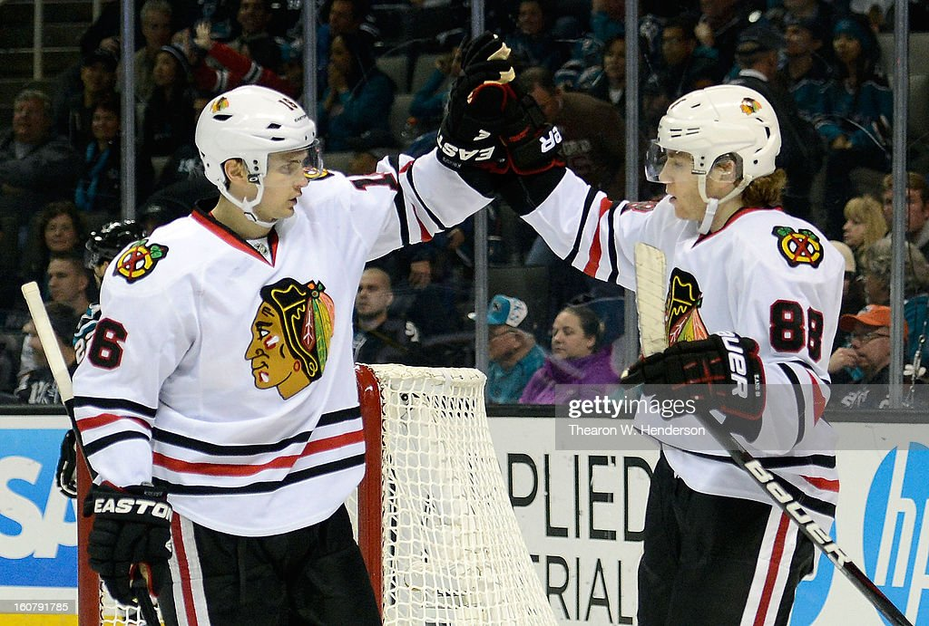 Patrick Kane #88 of the Chicago Blackhawks is congratulated by teammate Marcus Kruger #16 after Kane scored a goal against the San Jose Sharks in the third period at HP Pavilion on February 5, 2013 in San Jose, California. The Blackhawks won the game 5-3.
