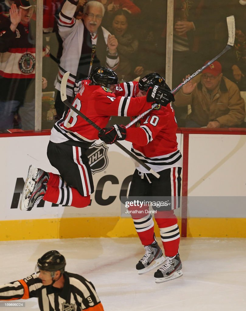 Patrick Kane #88 of the Chicago Blackhawks jumps into the arms of <a gi-track='captionPersonalityLinkClicked' href=/galleries/search?phrase=Patrick+Sharp&family=editorial&specificpeople=206279 ng-click='$event.stopPropagation()'>Patrick Sharp</a> #10 after scoring a goal the St. Louis Blues at the United Center on January 22, 2013 in Chicago, Illinois.