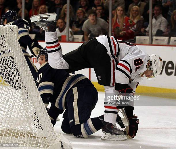 Patrick Kane of the Chicago Blackhawks keeps his balance after colliding with Kris Russell of the Columbus Blue Jackets at the United Center on...