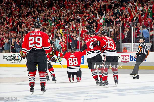 Patrick Kane of the Chicago Blackhawks kneels on the ice in celebration after scoring his third goal of the night to attain a hattrick and give the...