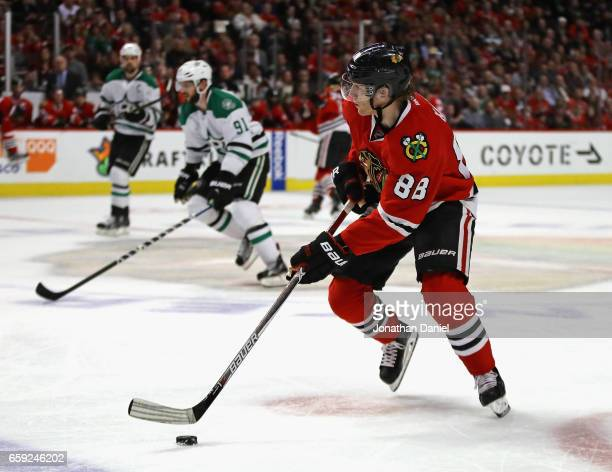 Patrick Kane of the Chicago Blackhawks looks to pass against the Dallas Stars at the United Center on March 23 2017 in Chicago Illinois The...