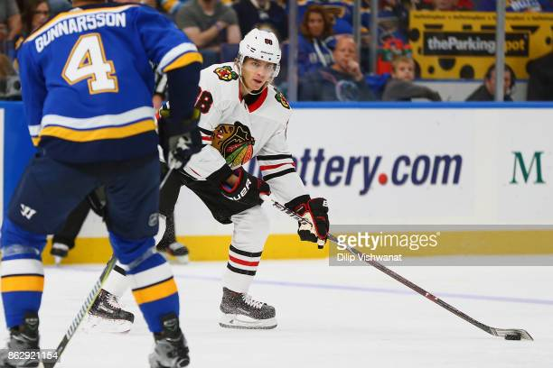 Patrick Kane of the Chicago Blackhawks looks to pass the puck against the St Louis Blues in the second period at the Scottrade Center on October 18...