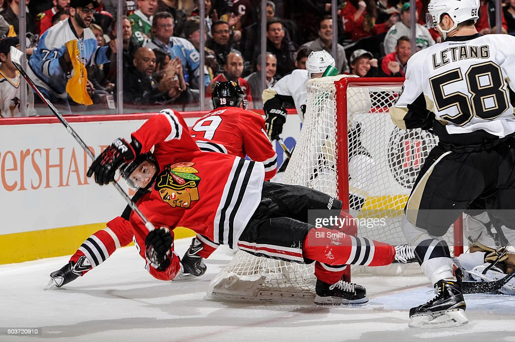 Patrick Kane #88 of the Chicago Blackhawks loses his footing in front of the net in the second period of the NHL game against the Pittsburgh Penguins at the United Center on January 6, 2016 in Chicago, Illinois.