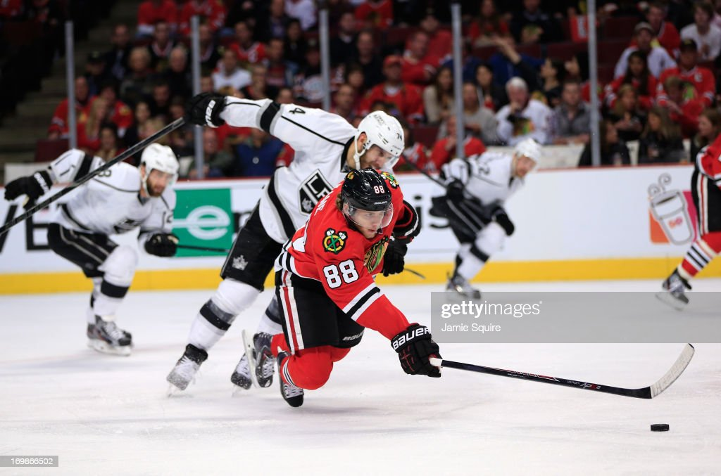 Patrick Kane #88 of the Chicago Blackhawks lunges for the puck while <a gi-track='captionPersonalityLinkClicked' href=/galleries/search?phrase=Dwight+King+-+Ice+Hockey+Player&family=editorial&specificpeople=4537297 ng-click='$event.stopPropagation()'>Dwight King</a> #74 of the Los Angeles Kings gives pursuit in the second period of Game Two of the Western Conference Final during the 2013 NHL Stanley Cup Playoffs at United Center on June 2, 2013 in Chicago, Illinois. The Blackhawks defeated the Kings 4-2.