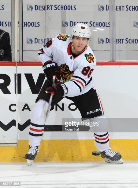 Patrick Kane of the Chicago Blackhawks passes the puck against the Arizona Coyotes at Gila River Arena on October 21 2017 in Glendale Arizona