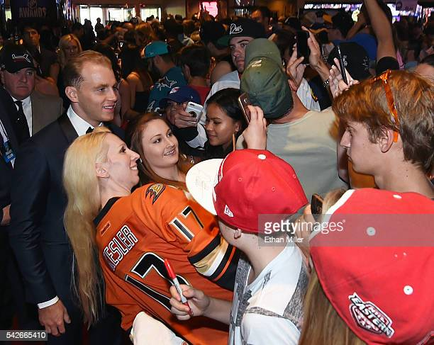 Patrick Kane of the Chicago Blackhawks poses with fans as he arrives at the 2016 NHL Awards at the Hard Rock Hotel Casino on June 22 2016 in Las...
