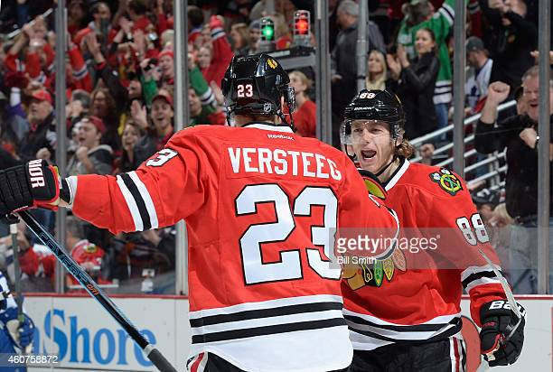 Patrick Kane of the Chicago Blackhawks reacts after Kris Versteeg scored against the Toronto Maple Leafs in the first period during the NHL game at...