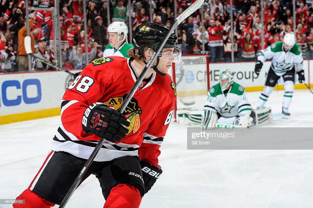 <a gi-track='captionPersonalityLinkClicked' href=/galleries/search?phrase=Patrick+Kane&family=editorial&specificpeople=1977261 ng-click='$event.stopPropagation()'>Patrick Kane</a> #88 of the Chicago Blackhawks reacts after scoring against the Dallas Stars in the second period of the NHL game at the United Center on January 4, 2015 in Chicago, Illinois.