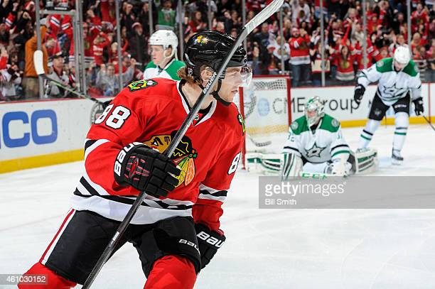 Patrick Kane of the Chicago Blackhawks reacts after scoring against the Dallas Stars in the second period of the NHL game at the United Center on...