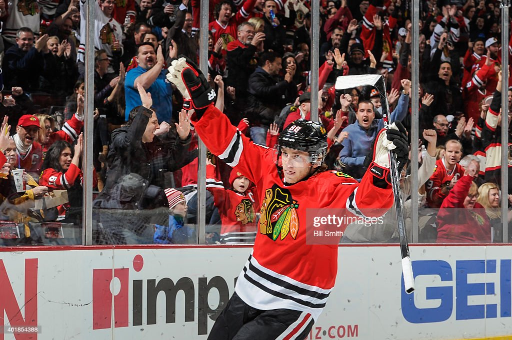 <a gi-track='captionPersonalityLinkClicked' href=/galleries/search?phrase=Patrick+Kane&family=editorial&specificpeople=1977261 ng-click='$event.stopPropagation()'>Patrick Kane</a> #88 of the Chicago Blackhawks reacts after scoring against the Arizona Coyotes in the second period during the NHL game at the United Center on January 20, 2015 in Chicago, Illinois.