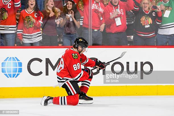 Patrick Kane of the Chicago Blackhawks reacts after scoring his third goal against the Boston Bruins for a hattrick during the NHL game at the United...