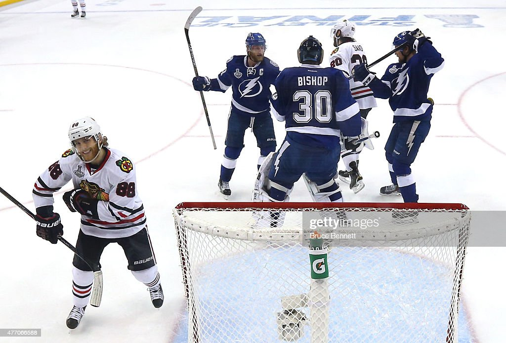 <a gi-track='captionPersonalityLinkClicked' href=/galleries/search?phrase=Patrick+Kane&family=editorial&specificpeople=1977261 ng-click='$event.stopPropagation()'>Patrick Kane</a> #88 of the Chicago Blackhawks reacts as <a gi-track='captionPersonalityLinkClicked' href=/galleries/search?phrase=Ben+Bishop&family=editorial&specificpeople=700137 ng-click='$event.stopPropagation()'>Ben Bishop</a> #30 of the Tampa Bay Lightning talks with <a gi-track='captionPersonalityLinkClicked' href=/galleries/search?phrase=Steven+Stamkos&family=editorial&specificpeople=4047623 ng-click='$event.stopPropagation()'>Steven Stamkos</a> #91 during Game Five of the 2015 NHL Stanley Cup Final at Amalie Arena on June 13, 2015 in Tampa, Florida.