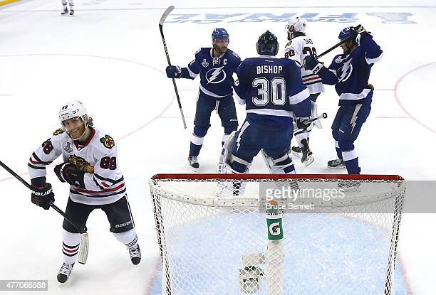 Patrick Kane of the Chicago Blackhawks reacts as Ben Bishop of the Tampa Bay Lightning talks with Steven Stamkos during Game Five of the 2015 NHL...