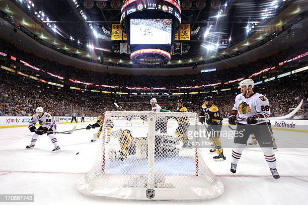 Patrick Kane of the Chicago Blackhawks scores a goal against Tuukka Rask of the Boston Bruins during the second period in Game Four of the 2013 NHL...