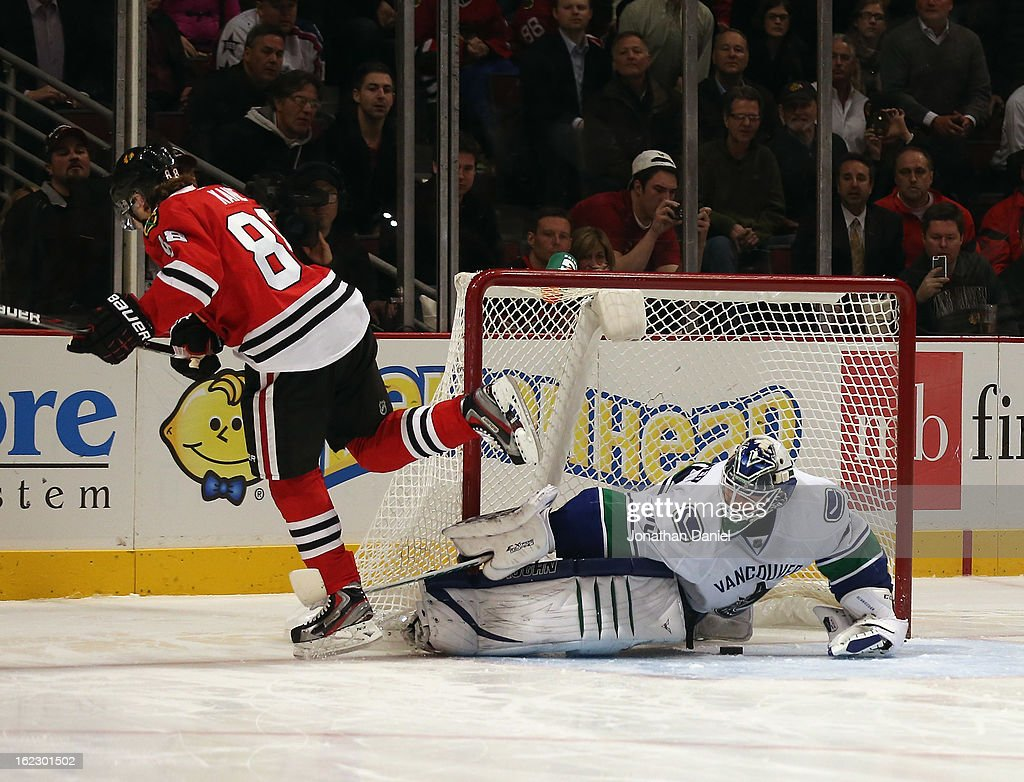 Patrick Kane #88 of the Chicago Blackhawks scores a goal in the shootout and is tripped by <a gi-track='captionPersonalityLinkClicked' href=/galleries/search?phrase=Cory+Schneider&family=editorial&specificpeople=696908 ng-click='$event.stopPropagation()'>Cory Schneider</a> #35 of the Vancouver Canucks at the United Center on February 19, 2013 in Chicago, Illinois. The Blackhawks defeated the Canucks 4-3 in a shootout.