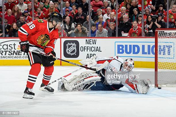 Patrick Kane of the Chicago Blackhawks scores on goalie Braden Holtby of the Washington Capitals in the first period of the NHL game at the United...