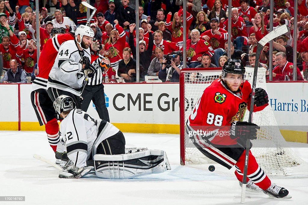 Patrick Kane #88 of the Chicago Blackhawks scores on goalie <a gi-track='captionPersonalityLinkClicked' href=/galleries/search?phrase=Jonathan+Quick&family=editorial&specificpeople=2271852 ng-click='$event.stopPropagation()'>Jonathan Quick</a> #32 of the Los Angeles Kings, as <a gi-track='captionPersonalityLinkClicked' href=/galleries/search?phrase=Robyn+Regehr&family=editorial&specificpeople=171828 ng-click='$event.stopPropagation()'>Robyn Regehr</a> #44 of the Kings watches the puck as it rolls back out of the net, in Game Five of the Western Conference Final during the 2013 Stanley Cup Playoffs at the United Center on June 08, 2013 in Chicago, Illinois.