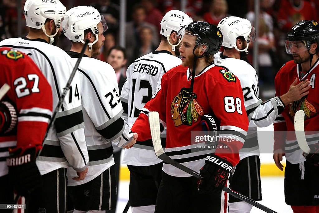 Patrick Kane #88 of the Chicago Blackhawks shakes hands with Dustin Brown #23 of the Los Angeles Kings during Game Seven of the Western Conference Final in the 2014 Stanley Cup Playoffs at United Center on June 1, 2014 in Chicago, Illinois.