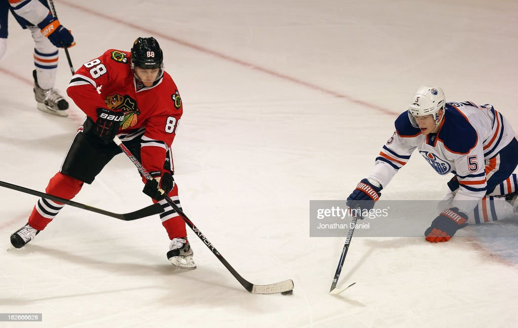 Patrick Kane of the Chicago Blackhawks shoots against Ladislav Smid of the Edmonton Oilers to score a goal in the 1st period at the United Center on...