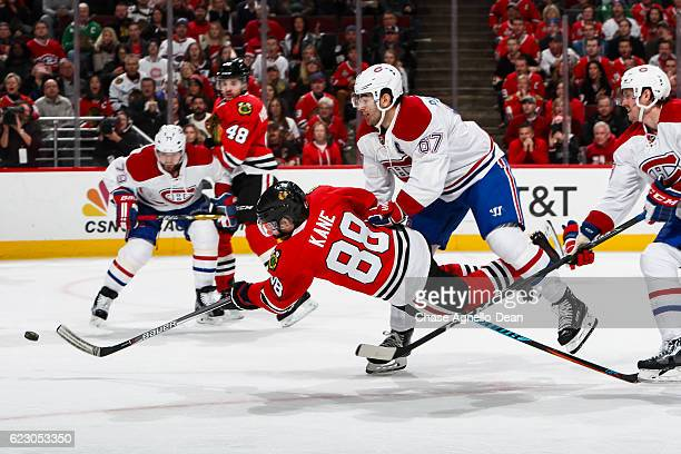Patrick Kane of the Chicago Blackhawks shoots the puck against Max Pacioretty and Jeff Petry of the Montreal Canadiens resulting in a goal in the...