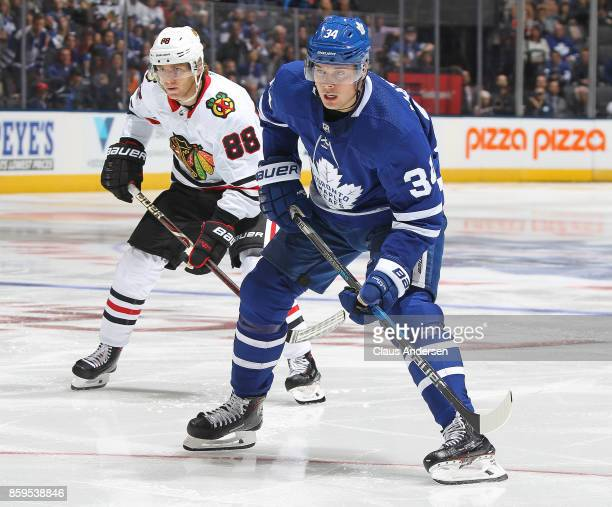 Patrick Kane of the Chicago Blackhawks skates against Auston Matthews of the Toronto Maple Leafs in an NHL game at the Air Canada Centre on October 9...