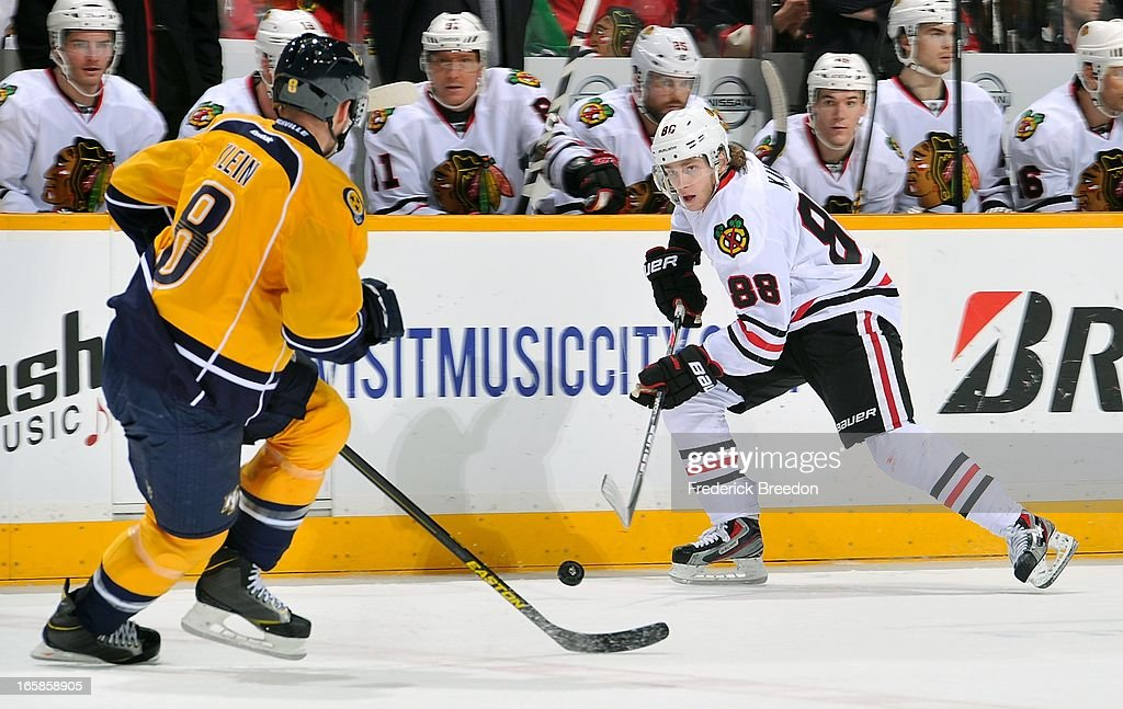 Patrick Kane #88 of the Chicago Blackhawks skates against Kevin Klein #8 of the Nashville Predators at the Bridgestone Arena on April 6, 2013 in Nashville, Tennessee.