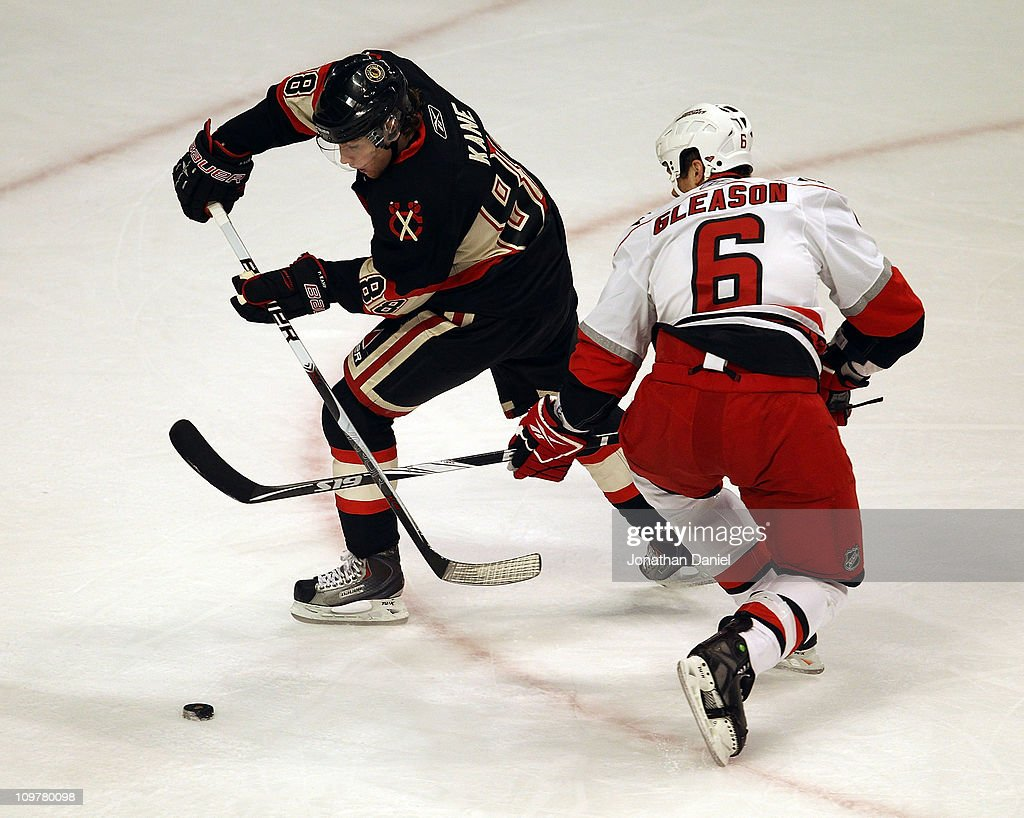 Patrick Kane #88 of the Chicago Blackhawks skates around <a gi-track='captionPersonalityLinkClicked' href=/galleries/search?phrase=Tim+Gleason&family=editorial&specificpeople=211575 ng-click='$event.stopPropagation()'>Tim Gleason</a> #6 of the Carolina Hurricanes at the United Center on March 4, 2011 in Chicago, Illinois.