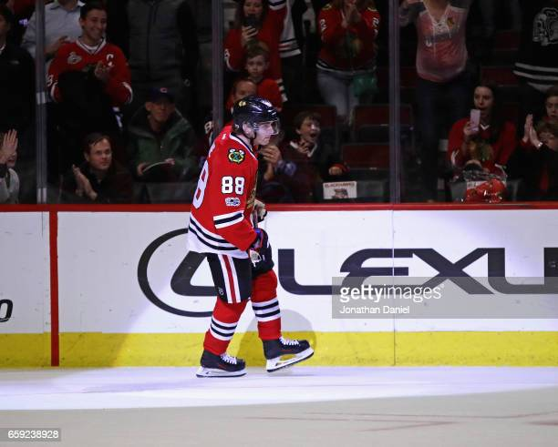 Patrick Kane of the Chicago Blackhawks skates back to the bench after scoring a goal in a shootout againt the Dallas Stars at the United Center on...