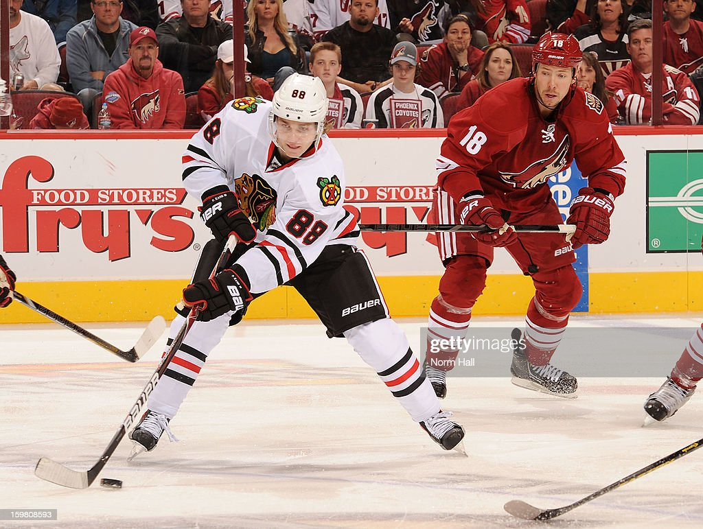 Patrick Kane #88 of the Chicago Blackhawks skates the puck through center ice against the Phoenix Coyotes at Jobing.com Arena on January 20, 2013 in Glendale, Arizona.