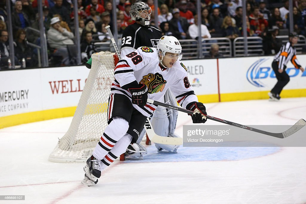Patrick Kane #88 of the Chicago Blackhawks skates up ice as goaltender <a gi-track='captionPersonalityLinkClicked' href=/galleries/search?phrase=Jonathan+Quick&family=editorial&specificpeople=2271852 ng-click='$event.stopPropagation()'>Jonathan Quick</a> #32 of the Los Angeles Kings looks on in the third period of the NHL game at Staples Center on February 3, 2014 in Los Angeles, California. The Blackhawks defeated the Kings 5-3.