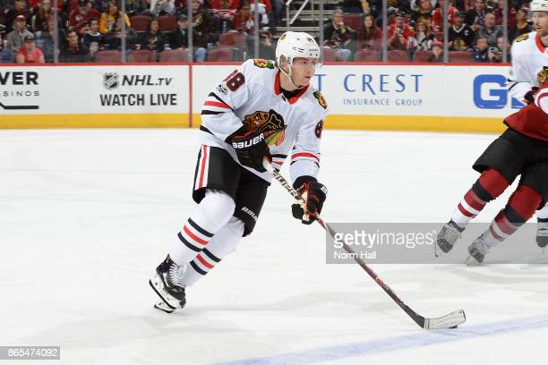 Patrick Kane of the Chicago Blackhawks skates with the puck against the Arizona Coyotes at Gila River Arena on October 21 2017 in Glendale Arizona