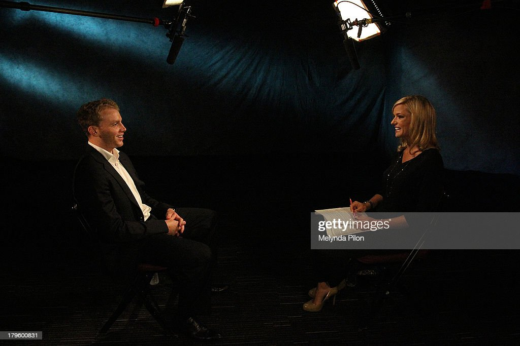 Patrick Kane of the Chicago Blackhawks speaks tp Kathryn Tappen during a NHL Network interview at the 2013 NHL Player Media Tour at the Prudential Center on September 5, 2013 in Newark, New Jersey.