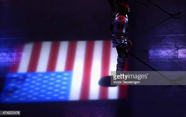 Patrick Kane of the Chicago Blackhawks stands on the ice during the singing of the national anthem before playing the Anaheim Ducks in Game Two of...