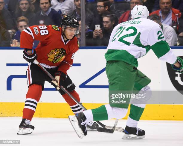 Patrick Kane of the Chicago Blackhawks tries to get around Nikita Zaitsev of the Toronto Maple Leafs during the second period at the Air Canada...