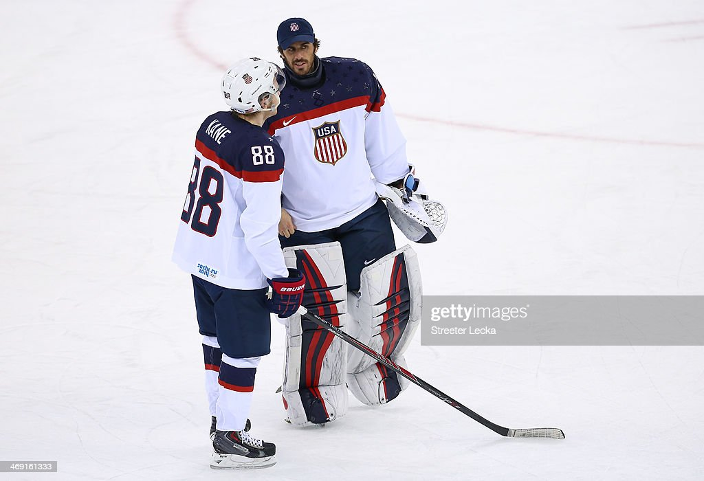 Patrick Kane #88 of United States and Ryan Miller #39 of United States talk after the 7-1 win against Slovakia during the Men's Ice Hockey Preliminary Round Group A game on day six of the Sochi 2014 Winter Olympics at Shayba Arena on February 13, 2014 in Sochi, Russia.
